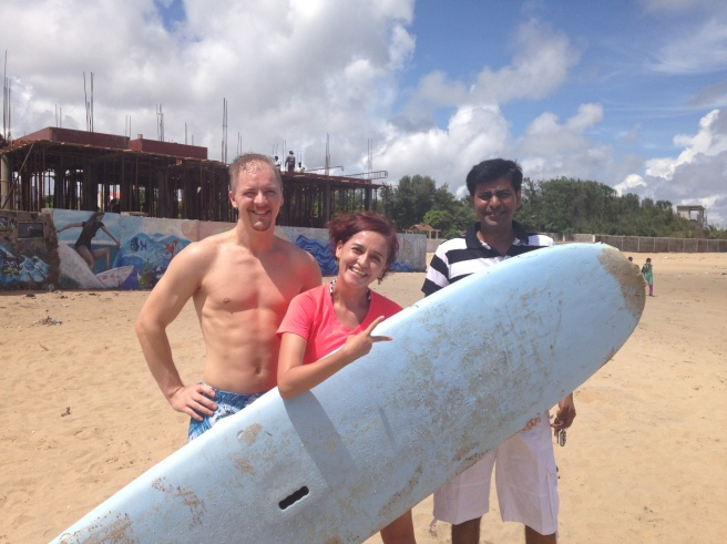 Alton, Mónica, and Ajit at Covelong Point with Surfboard