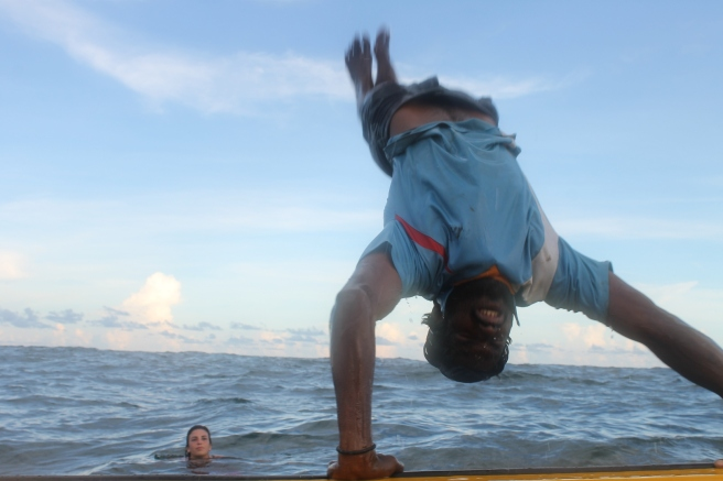 fisherman-handstand-flip-from-boat