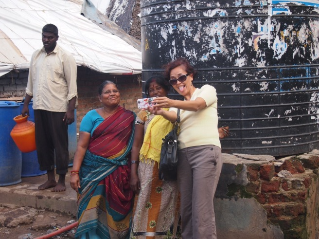 Mónica taking selfies with strangers, Chennai, India